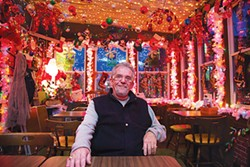 Bob Paganico, of the Spirit of Christmas, sits in his bar Bob's Garage Restaurant and Lounge. - PHOTO BY THEO SCHWARZ