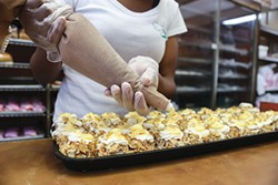 Making mini burnt almond tortes at Prantl's - PHOTO BY MIKE SCHWARZ