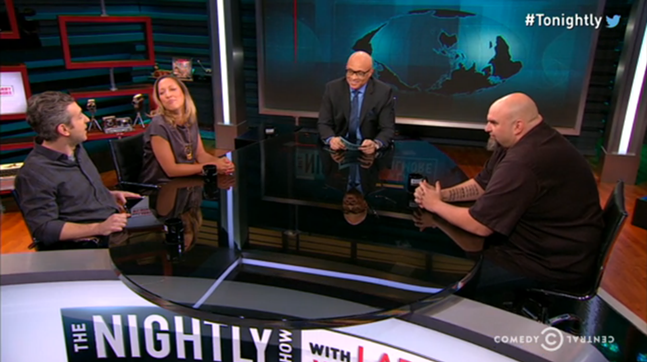 Braddock Mayor John Fetterman (right) is seen during his appearance on The Nightly Show with Larry Wilmore (center) Thursday evening - WWW.COMEDYCENTRAL.COM