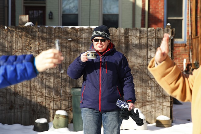 Newlywed Laura Dunhoff takes a sip of hot cider while Sue Kerr FaceTimes with the son of Sarah Hartman. - CP PHOTO: JARED WICKERHAM