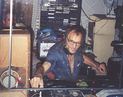 Mad Mike, spinning platters at Pietro's Pizza Pub, in 2000 - PHOTO BY AL HOFF