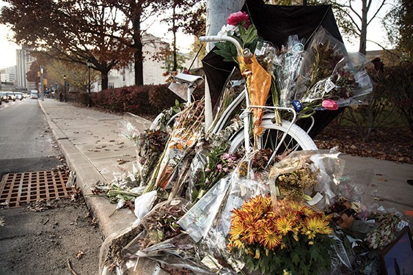 A ghost bike memorial in 2015 marking the spot on Forbes Avenue where cyclist Susan Hicks was killed. - CP FILE PHOTO: THEO SCHWARZ