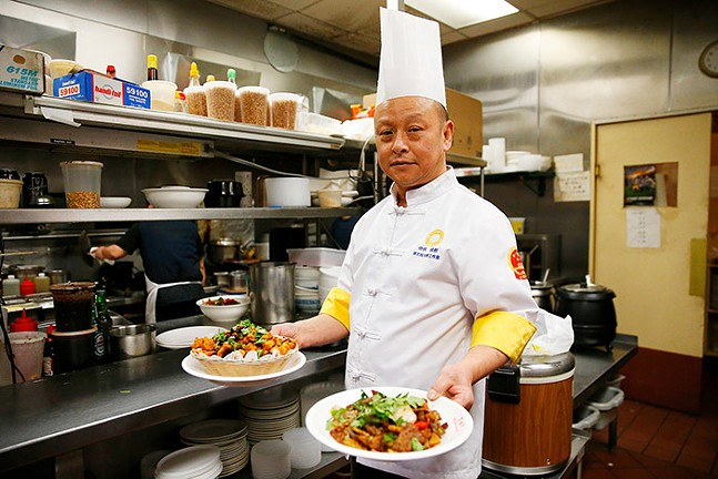 Chengdu Gourmet owner Wei Zhu poses for a portrait inside his Squirrel Hill restaurant. - CP PHOTO: JARED WICKERHAM