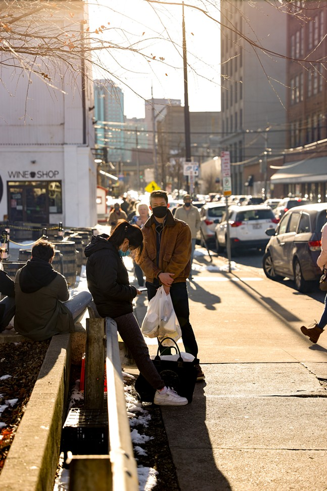 People gather outside in the Strip District on Saturday. - CP PHOTO: KAYCEE ORWIG