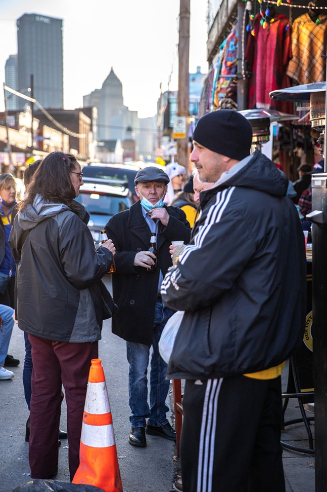 People gather for drinks outside on Penn Avenue in the Strip District on Saturday. - CP PHOTO: KAYCEE ORWIG