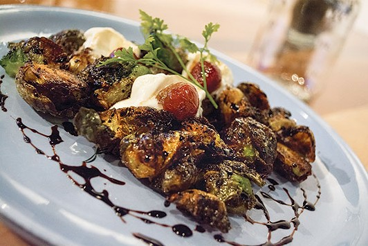 Fried Brussels sprouts with balsamic reduction, whipped goat cheese and roasted grapes - PHOTO BY SARAH WILSON