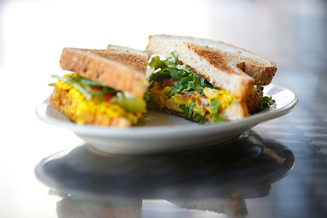 A breakfast sandwich made with a tofu scramble, vegan cheese, veganaise, arugula, and tomato on wheat bread from Kaibur Coffee & Cafe - CP PHOTO: JARED WICKERHAM