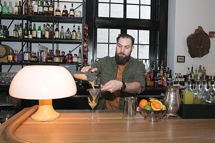 Ace Hotel bartender Michael Molnar makes The Fairweather cocktail - PHOTO BY JOHN COLOMBO