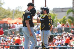 Catcher Francisco Cervelli has a word with reliever Jared Hughes. - PHOTO BY CHARLIE DEITCH