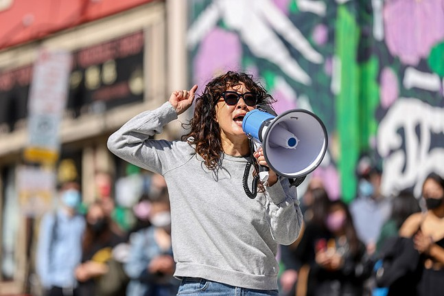 Actress Sandra Oh, in Pittsburgh filming for Netflix, spoke to the crowd during a Stop Asian Hate protest on Sat., March 20, 2021. - CP PHOTO: KAYCEE ORWIG