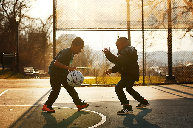 Brandon Scott and Jabril Green play basketball at the August Wilson Park. - CP PHOTO: JARED WICKERHAM
