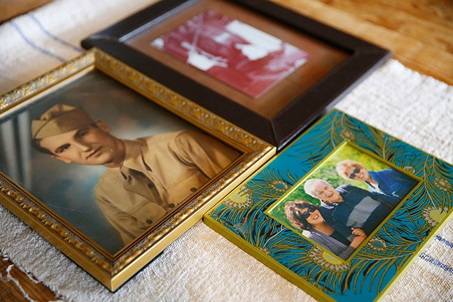 Photos of Chris Rosselot's grandfather and family members are shown on their dining room table in the North Side. - CP PHOTO: JARED WICKERHAM