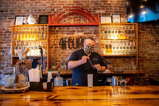Manager and distiller Jerry Sunday mixes drinks at 4Four6 Distillery. - CP PHOTO: KAYCEE ORWIG