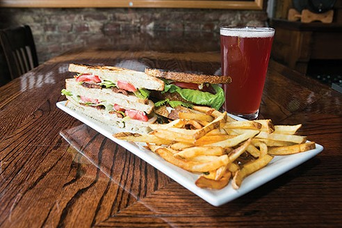 Pints on Penn: Roasted Turkey Club with House Bacon from Pints on Penn: Thick-sliced roasted turkey with lettuce, tomato, mayo and candied bacon - PHOTO BY JOHN COLOMBO