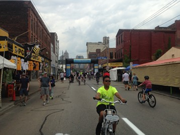 Patron riding a Healthy Ride bike as part of Open Streets festival - PHOTO BY RYAN DETO