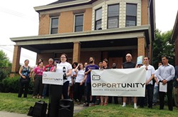 Jennifer Kennedy, of Pittsburgh United, announces goal of placing affordable-housing initiative on November ballot at a press conference in the North Side. - PHOTO BY RYAN DETO