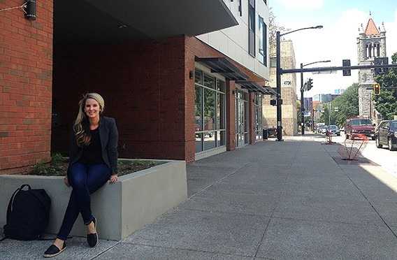 Rachel Reilly Carroll outside the Penn-Mathilda apartments, a new affordable-housing complex. - PHOTO BY RYAN DETO