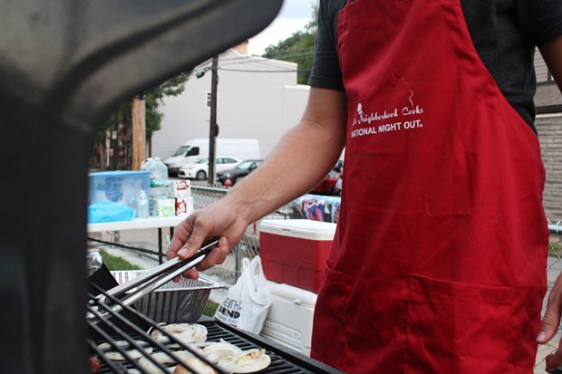 Event organizers yelled to passers by, asking if they'd like something to eat from off the grill. - CP PHOTO BY BILLY LUDT