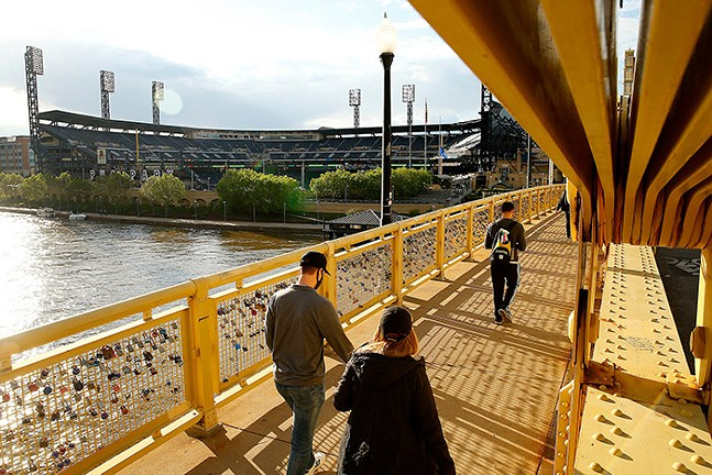 Fans cross the Roberto Clemente Bridge on their way to PNC Park before a Pittsburgh Pirates game against the San Francisco Giants on Thu., May 3, 2021. - CP PHOTO: JARED WICKERHAM