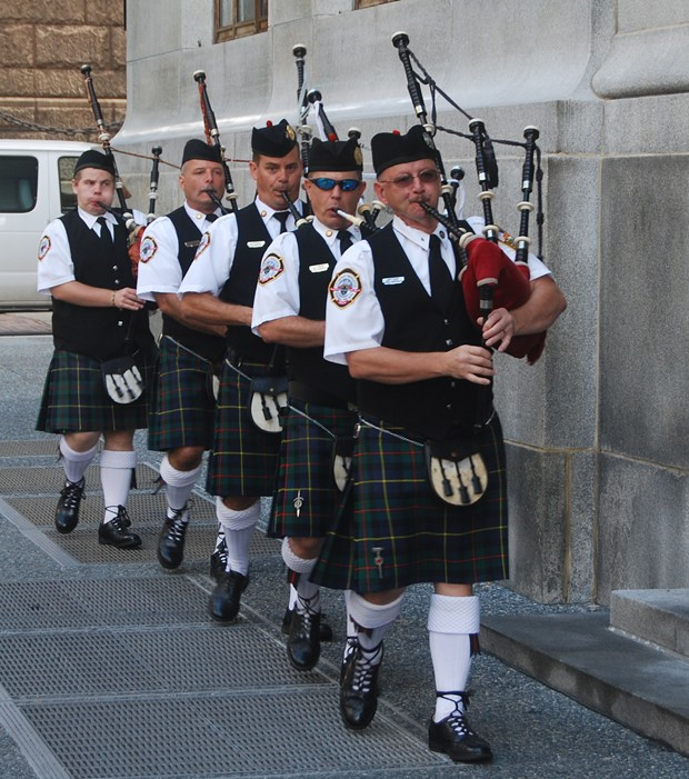 Bagpipers march toward the City-County Building - PHOTO BY RYAN DETO