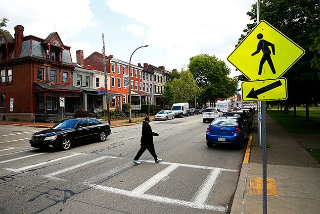 A man crosses a crosswalk at Sherman Avenue near the Mexican War Streets in the North Side on Thu., May 13, 2021. - CP PHOTO: JARED WICKERHAM