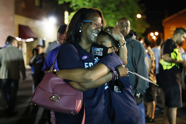 The son of mayoral candidate Ed Gainey, Darius, hugs his mom Michelle after Ed Gainey took the lead against incumbent Bill Peduto during his watch party. - CP PHOTO: JARED WICKERHAM
