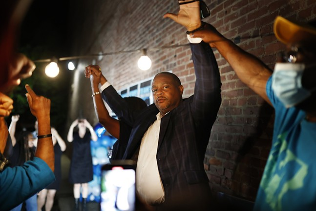 Democratic Mayoral candidate Ed Gainey celebrates after incumbent Bill Peduto conceded during his watch party at the OnePA offices in the North Side. - CP PHOTO: JARED WICKERHAM