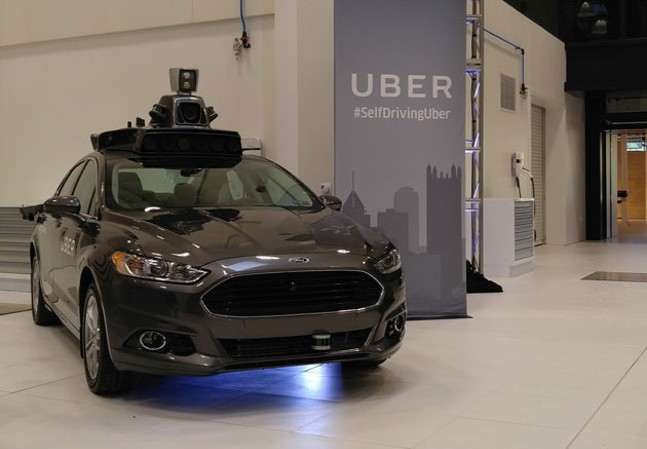A Ford Focus model of an Uber driverless car - CP PHOTO BY KIM LYONS