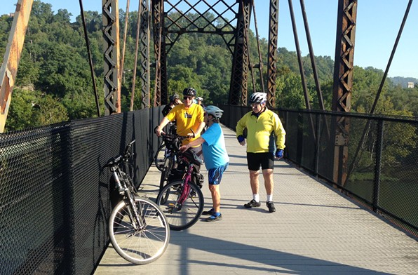 Rich Fitzgerald (left) taking a break on a bike/ped bridge over the Monongahela River. - CP PHOTO BY RYAN DETO