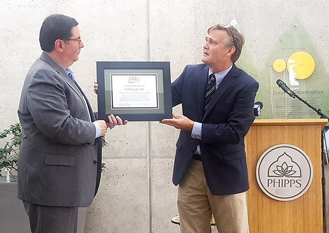 Tim Beatley (right) presents Mayor Bill Peduto with a Biophilic City certificate - CP PHOTO BY REBECCA ADDISON