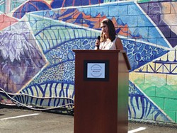 Betty Cruz presenting the community blueprint to help immigrants. - CP PHOTO BY RYAN DETO
