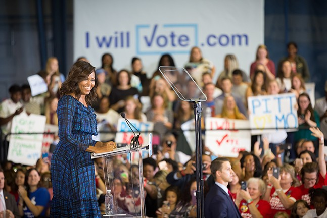 First Lady Michelle Obama speaks before a throng of supporters at the University of Pittsburgh - PHOTO BY RENEE ROSENSTEEL