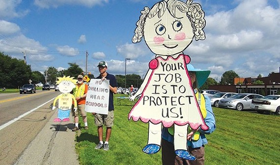 Anti-fracking protesters outside of Mars Area High School in Butler County in July 2015. - CP PHOTO BY ASHLEY MURRAY