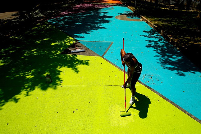 """Pittsburgh artist Janel Young painting """"Pathway to Joy"""" on Fort Duquesne Boulevard. - CP PHOTO: JARED WICKERHAM"""