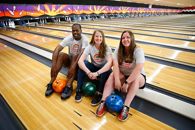 """Michael Gosha (captain of Balls Of Steel), Megan Entwistle (captain of Lickity Splits), and Lindsey Williams (captain of The Karen's) wearing Steel City Clothing's """"Pittsburgh is So Gay"""" Pride T-shirts. - CP PHOTO: JARED WICKERHAM"""