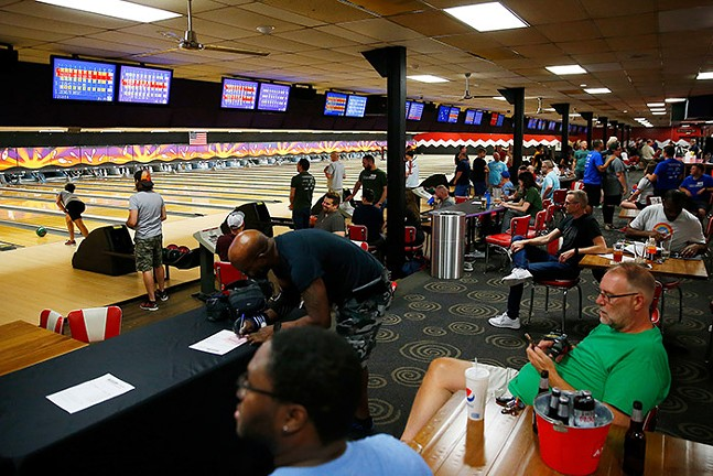Players bowl during the Stonewall Sports bowling league at the AMF Noble Manor Lanes. - CP PHOTO: JARED WICKERHAM