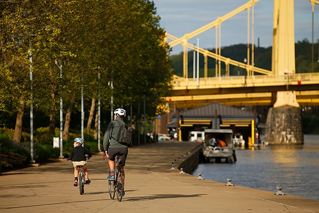 Cyclists on Pittsburgh's North Side - CP PHOTO: JARED WICKERHAM