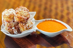 House-made tater tots, parmesan-bacon powder and piquillo aioli - CP PHOTO BY VANESSA SONG