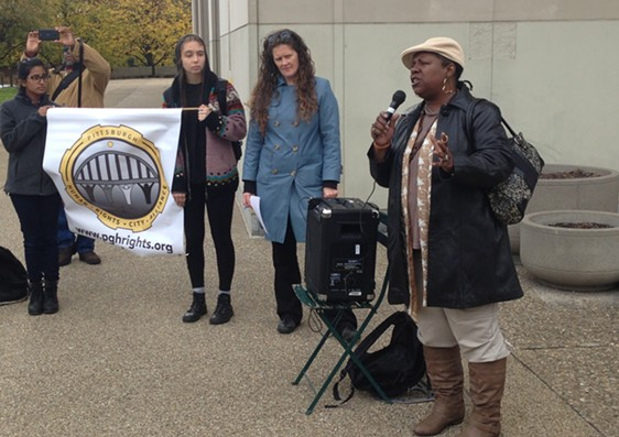 Mischelle McMillan speaks to the crowd at an affordable-housing rally in Oakland. - CP PHOTO BY RYAN DETO