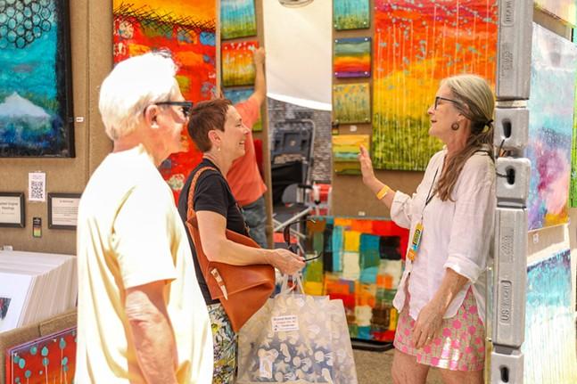 Artist Liz Nichtberger talks to festival goers. - CP PHOTO: KAYCEE ORWIG