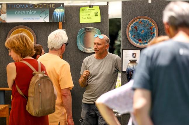 Artist Thomas Bothe speaks to festival goers. - CP PHOTO: KAYCEE ORWIG