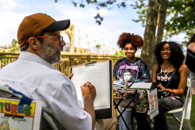 Howard Bender draws caricatures at the Three Rivers Arts Festival. - CP PHOTO: KAYCEE ORWIG