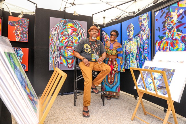 Painter Jay Durrah sits in his booth at the Three Rivers Arts Festival. - CP PHOTO: KAYCEE ORWIG