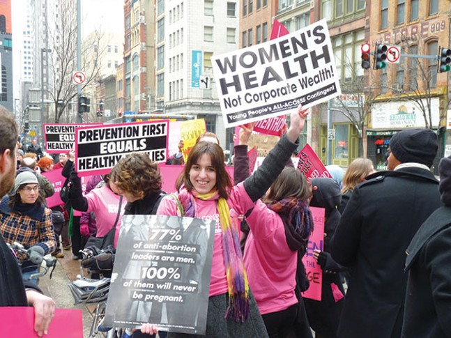 Protesters rally in support of Planned Parenthood in 2011 - CP FILE PHOTO