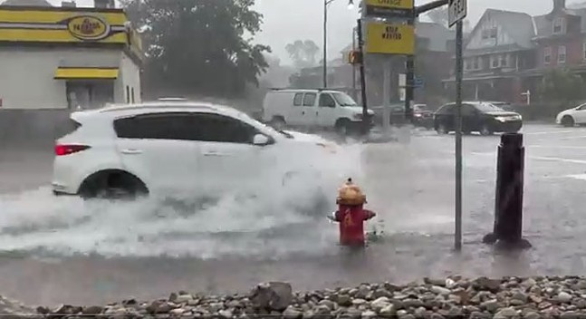 Screenshot of video of a driver moving through floodwaters in Greenfield - CP PHOTO: JARED WICKERHAM