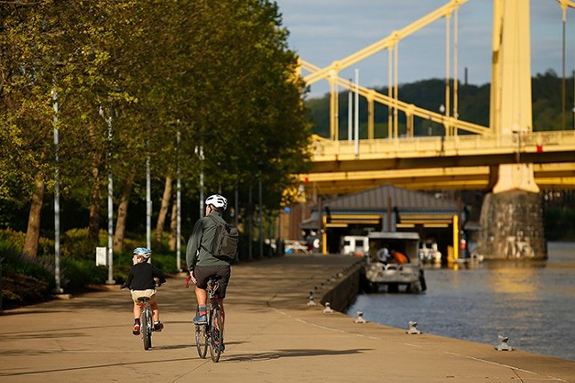 Cyclists on the Three Rivers Heritage Trail in Pittsburgh's North Shore in May - CP PHOTO: JARED WICKERHAM