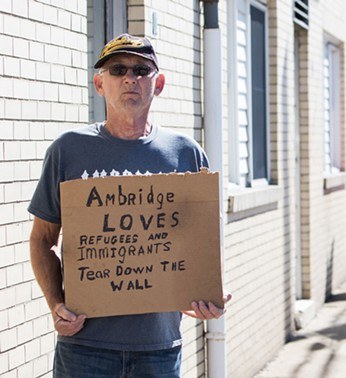 A protester during Donald Trump's visit to Ambridge - CP PHOTO BY LUKE THOR TRAVIS