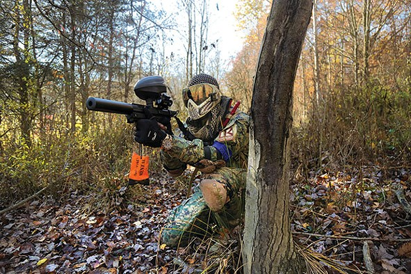 Carl Harrington, a.k.a. Death Card, takes a position during a scenario paintball game at Three Rivers Paintball in Freedom. - CP PHOTO BY THEO SCHWARZ