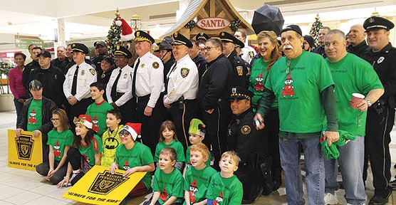 Jimmy Cvetic, right, and members of several local police departments will be distributing toys this week. - CP PHOTO BY KIM LYONS