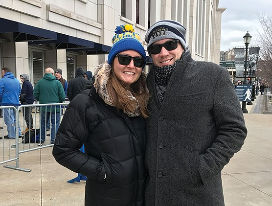 Alex and Caroline Plocki prepare to enter Yankee Stadium for the Pinstripe Bowl. - CP PHOTO BY PAUL GUGGENHEIMER